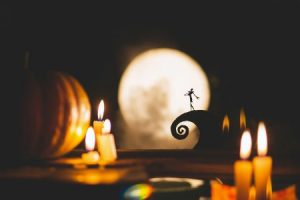 Silhouette of Jack Skellington with candles in the foreground