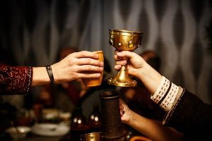 People toasting with renaissance cups